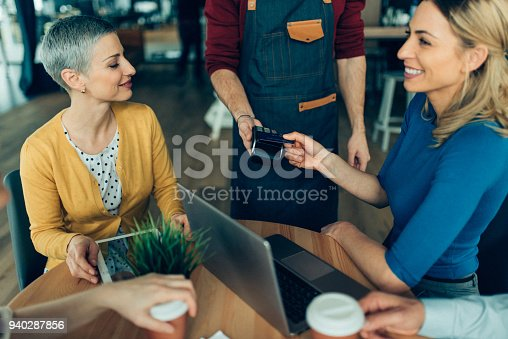 178974134istockphoto Business woman making contactless credit card payment 940287856