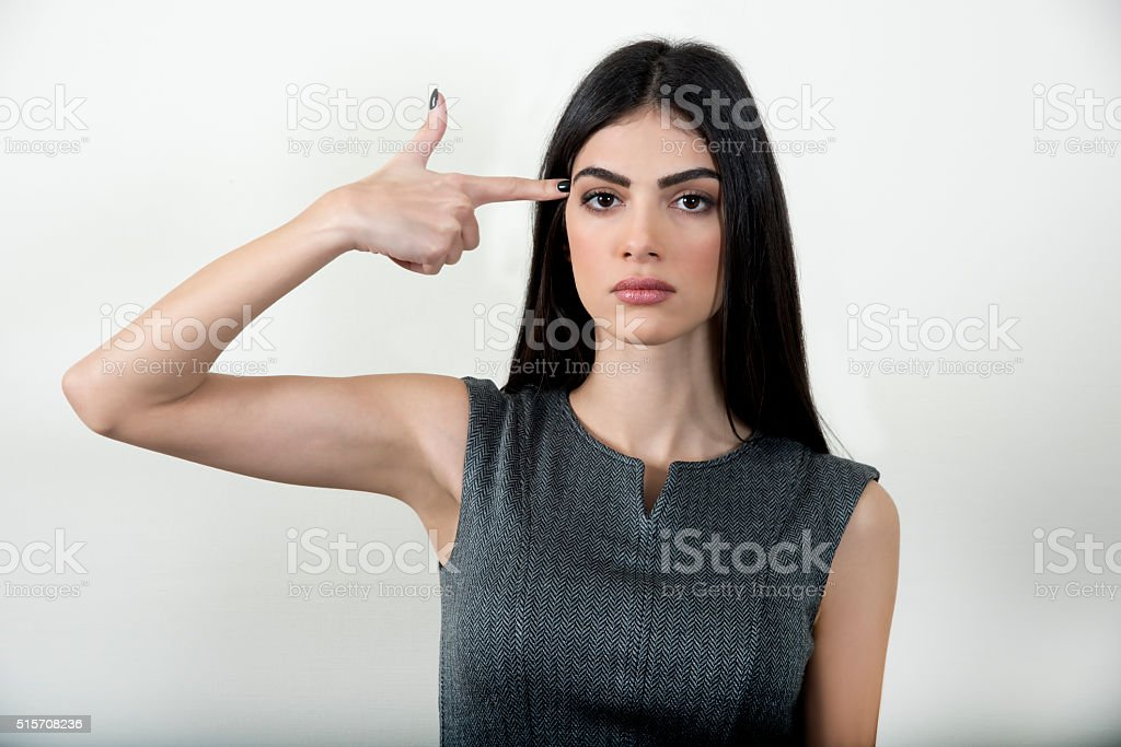 Business woman making gun with her hand. stock photo