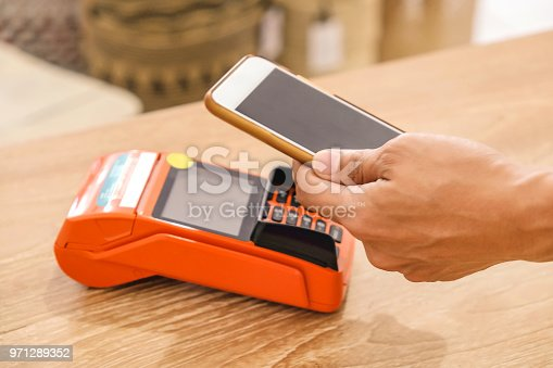 istock Business woman making mobile payment 971289352