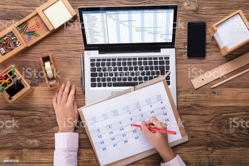 Business Woman Marking A Date On Calendar stock photo