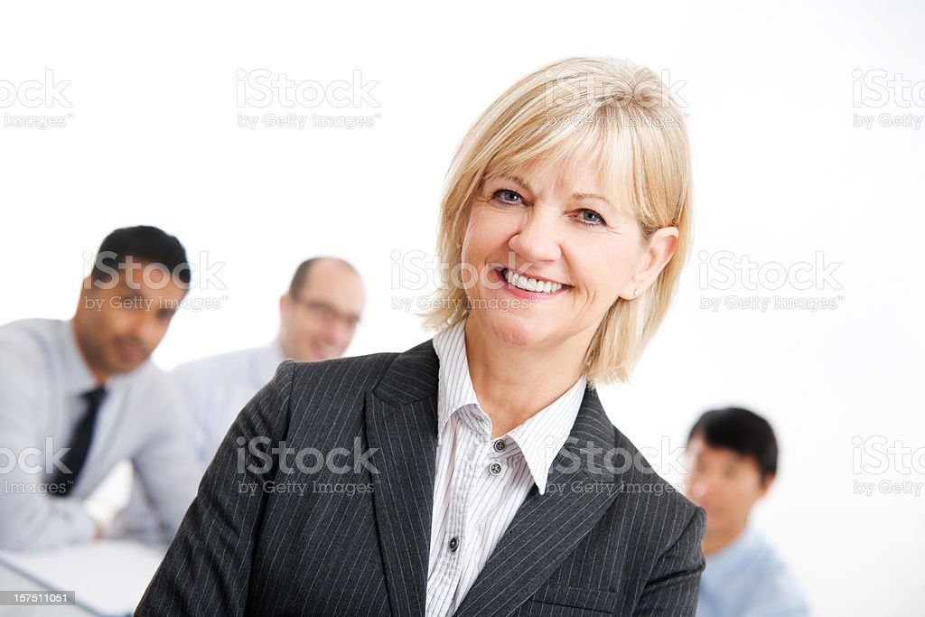Business Woman - Meeting Room with Work Group or Team royalty-free stock photo