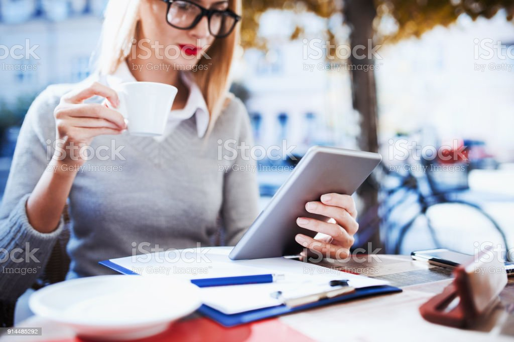 Business woman on coffee break in a cafe. Business, education, lifestyle concept stock photo
