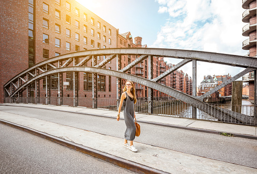 Business woman on the iron bridge