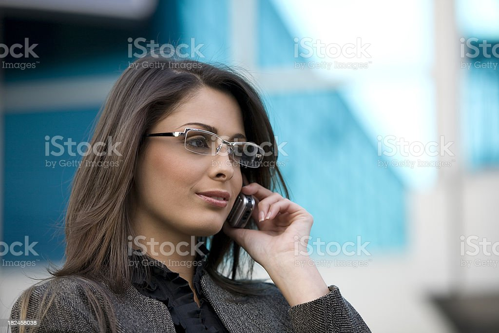 Business woman on the phone outdoors royalty-free stock photo