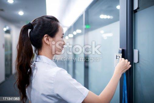 istock Business Woman Open The Office Door - XXXXXLarge 171341383
