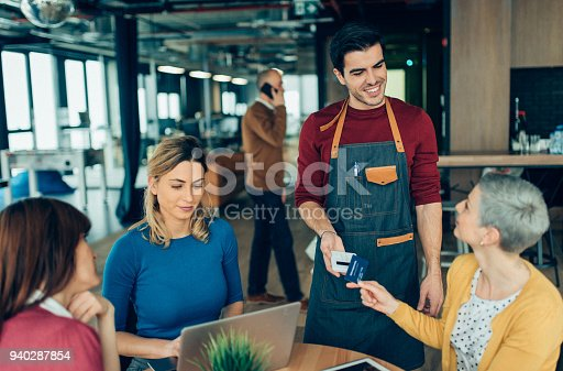 178974134istockphoto Business woman paying contactless 940287854