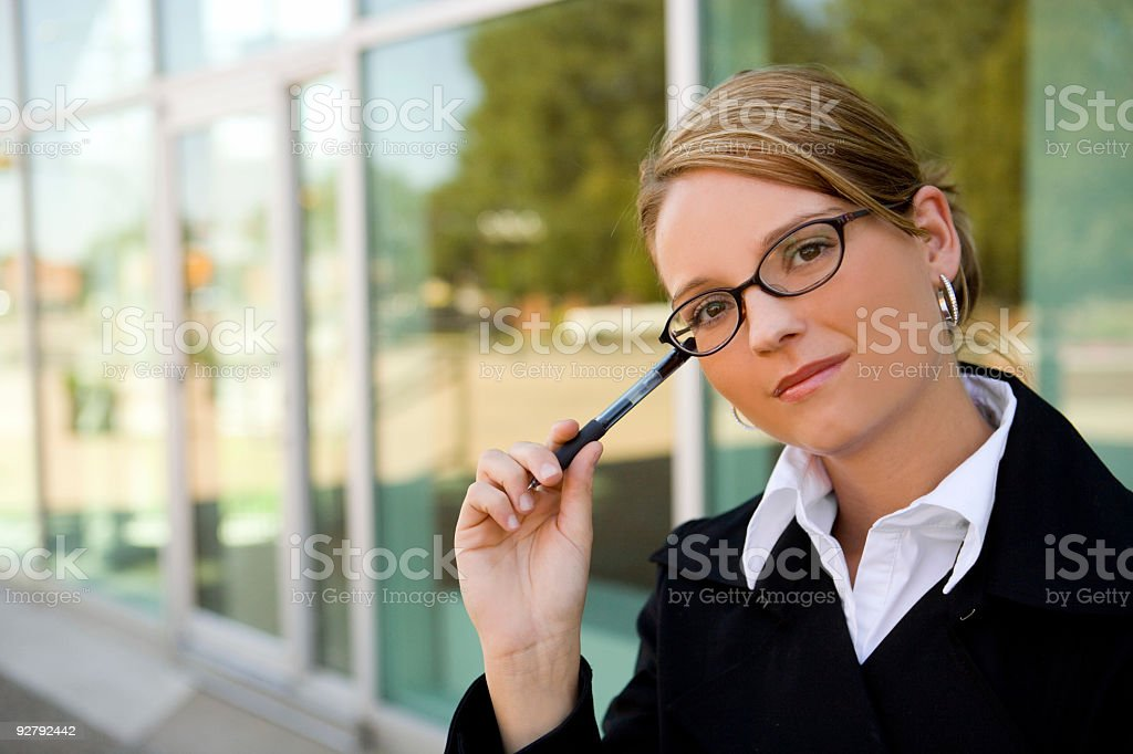 Business Woman / Pen / Thinking royalty-free stock photo