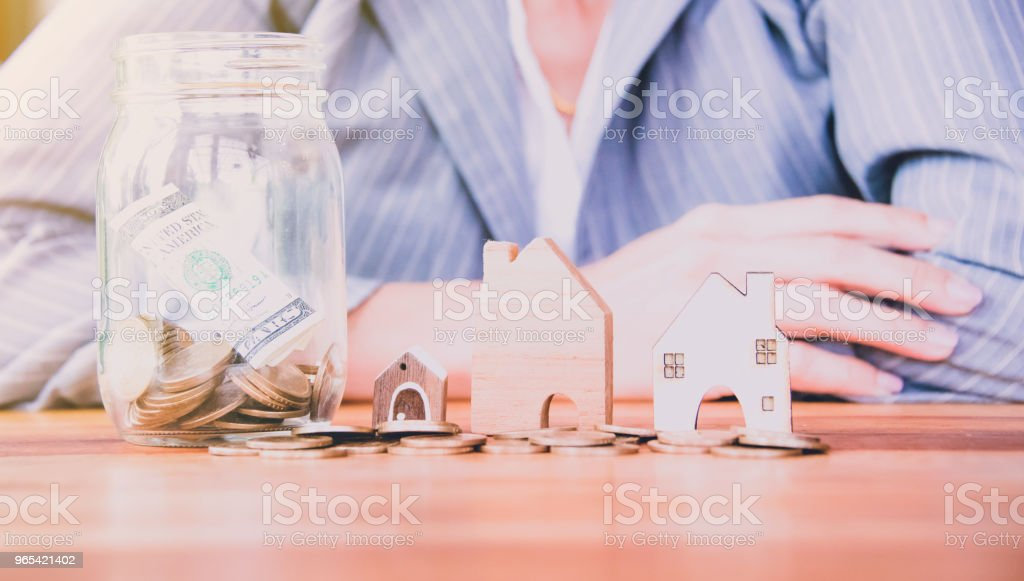 Business woman planning her money saving in the future royalty-free stock photo
