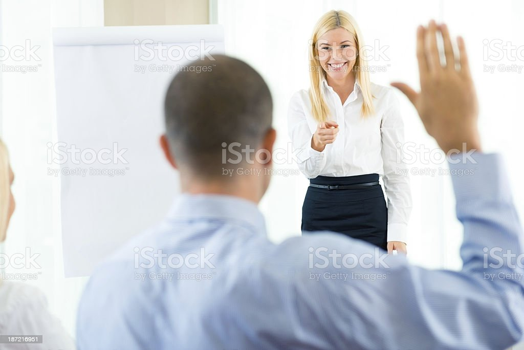 Business woman pointing at male colleague royalty-free stock photo