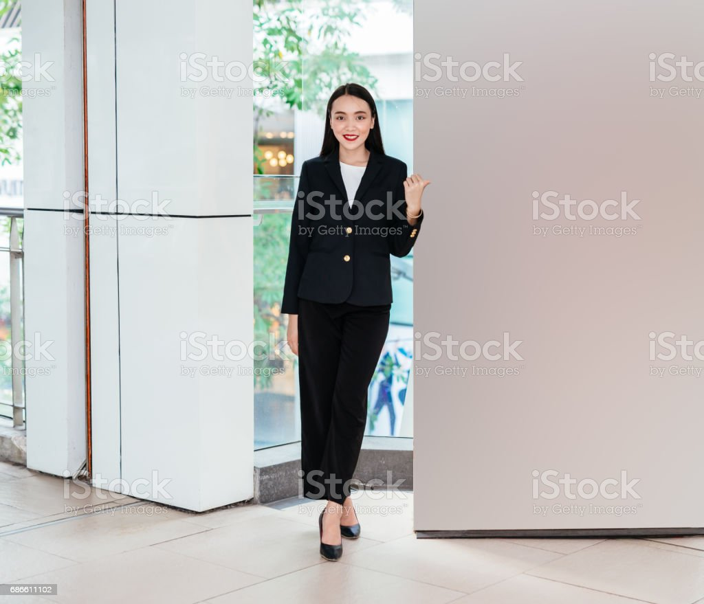 Business woman pointing to blank board the billboard. royalty-free stock photo