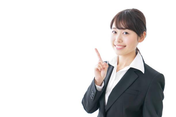 ビジネスの女性の何かを指しています。 - ビジネスフォーマル ストックフォトと画像