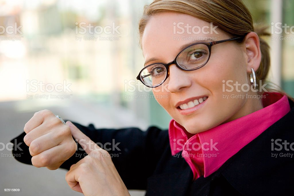 Business Woman / Pointing to watch royalty-free stock photo