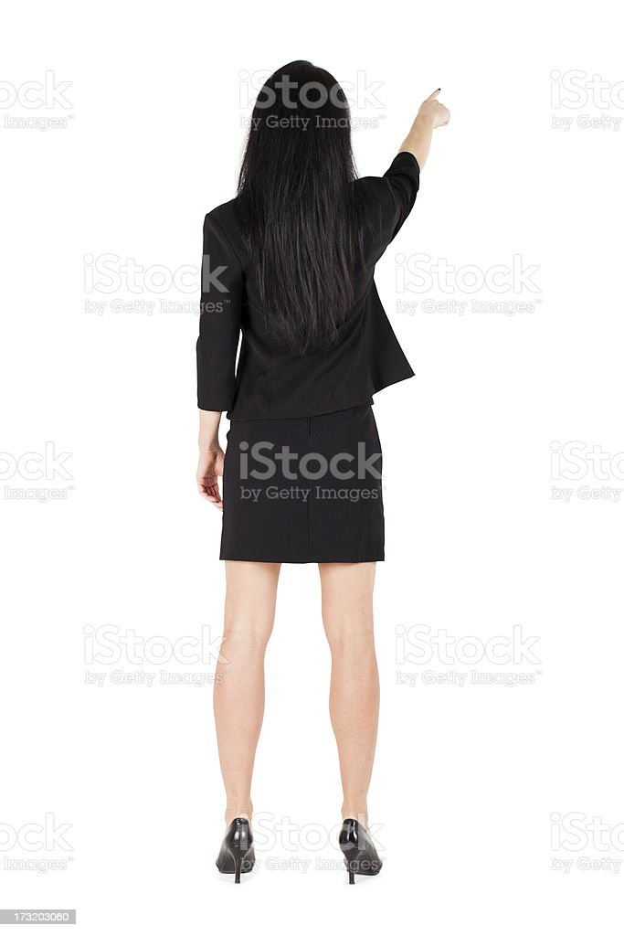 Business woman pointing turned backwards isolated royalty-free stock photo