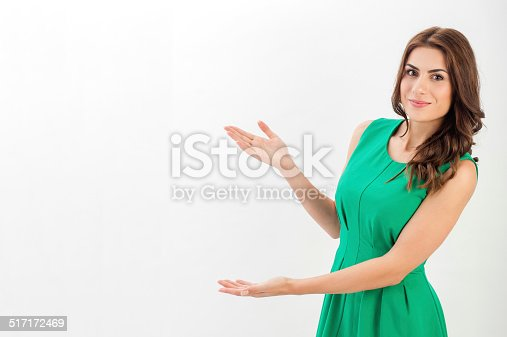 istock Business woman presenting a copyspace. 517172469