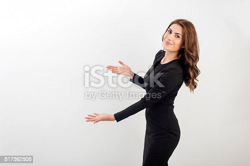 istock Business woman presenting a copyspace. 517362505