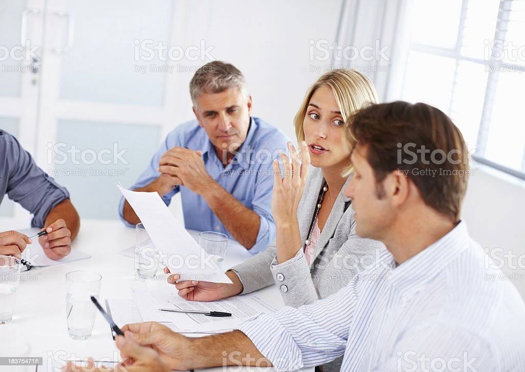 Business woman presenting her ideas to colleagues royalty-free stock photo