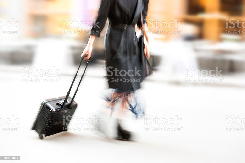 Business woman pulling cabin bag stock photo