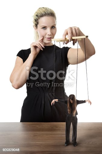 istock business woman puppet master 920329048