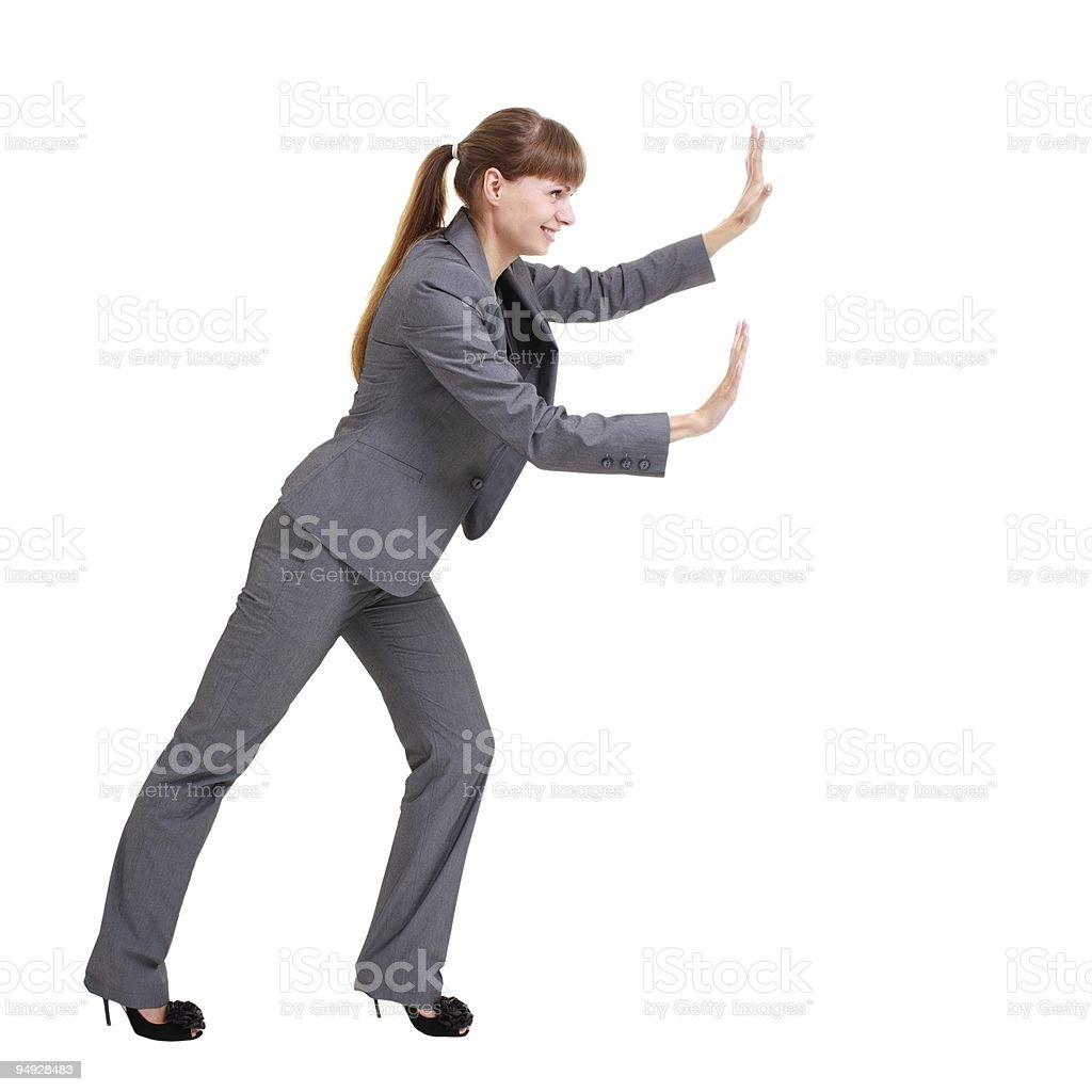 Business woman pushing something royalty-free stock photo