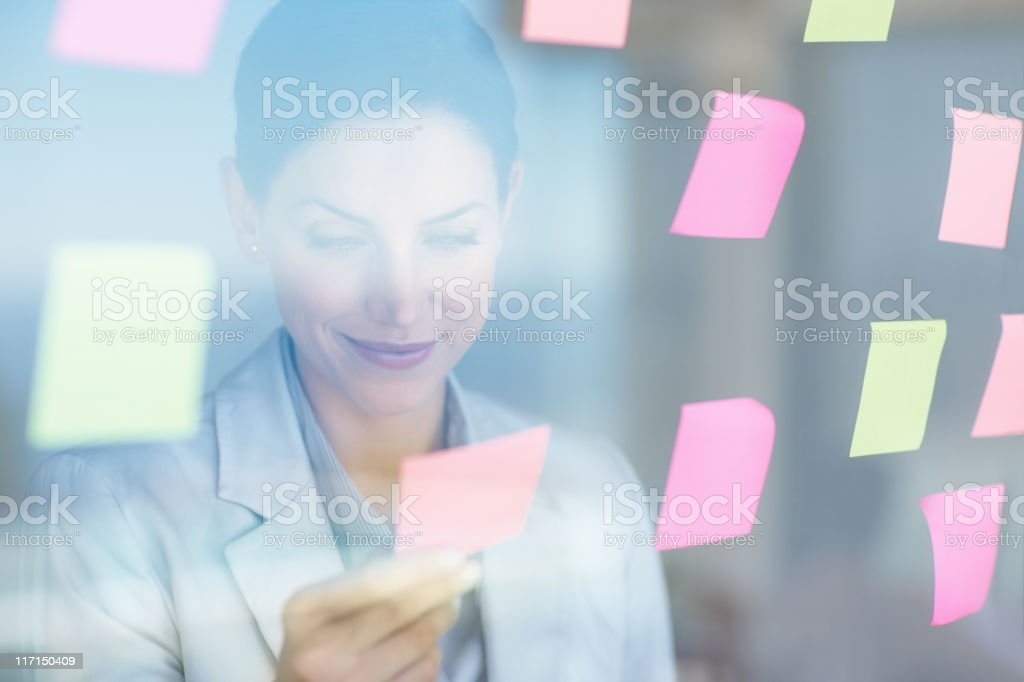 Business woman reading a note royalty-free stock photo