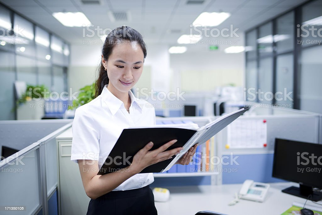 Business Woman Reading Documents - XXXXXLarge royalty-free stock photo