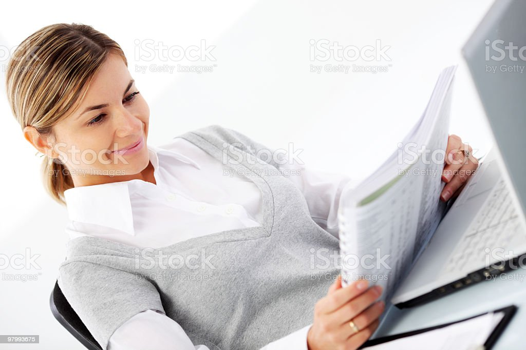 Business woman reading in the office. royalty-free stock photo