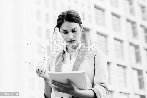 istock Business woman reading papers BNW 620701134