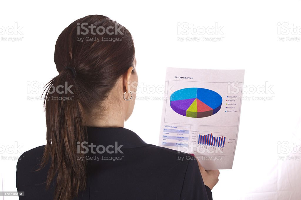 Business woman reads a report with charts royalty-free stock photo
