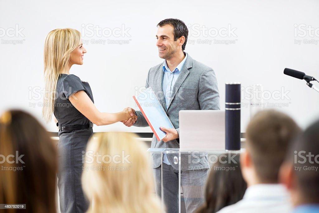 Business woman receiving an award. stock photo