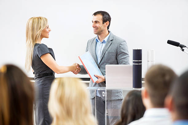 Business woman receiving an award. stock photo