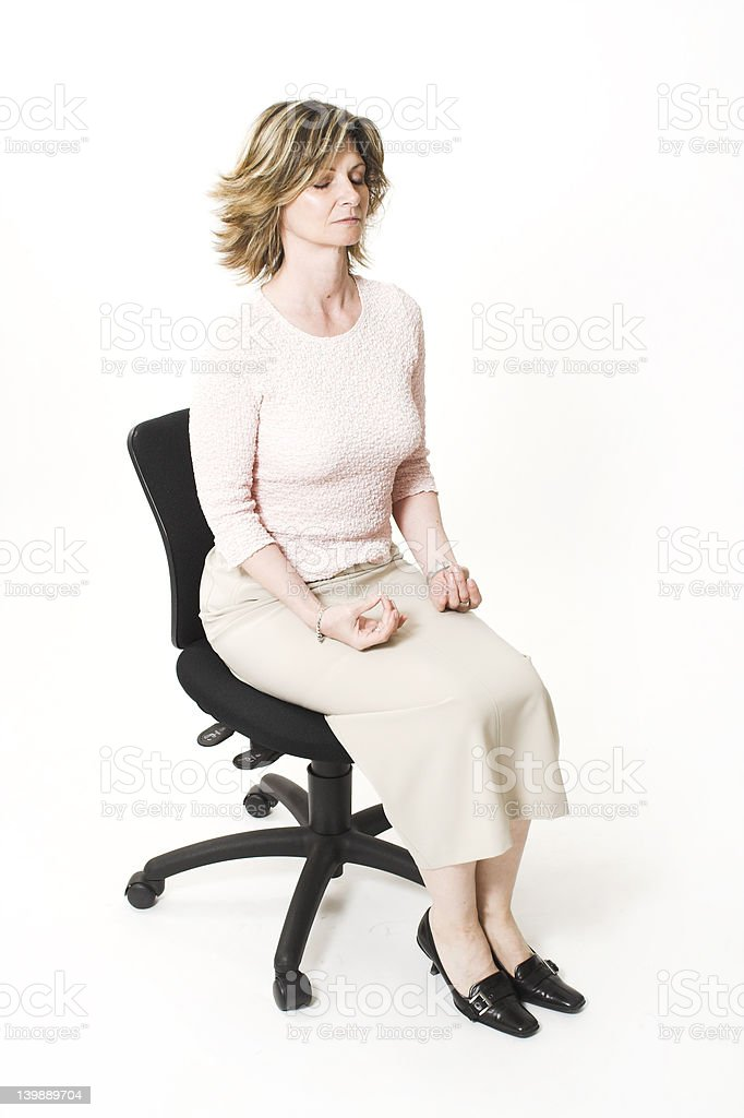 business woman relaxing on chair stock photo