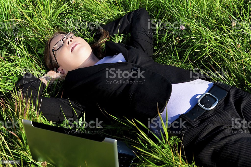 Business Woman Resting in the Grass stock photo