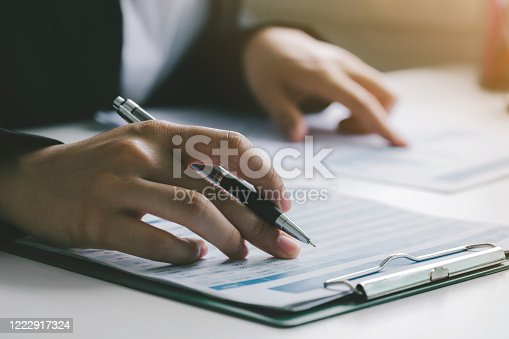 875087884 istock photo Business woman reviewing data in financial charts and graphs. Business Financing Accounting Banking Concept 1222917324
