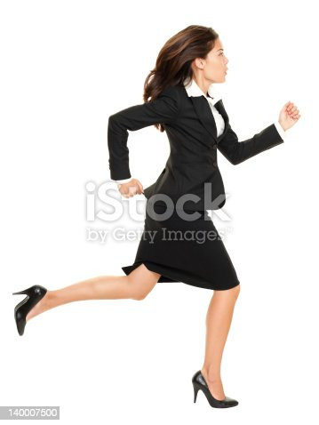 Business woman running in suit in full body isolated on white background. Business concept image with young mixed race Caucasian / Chinese Asian businesswoman. Click for more: