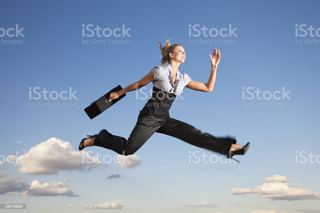 Business woman running through the air stock photo