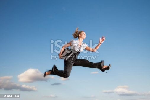 istock Business woman running through the air 154932269
