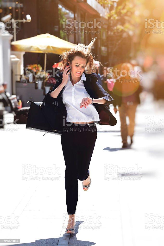 Business woman rushing to work stock photo