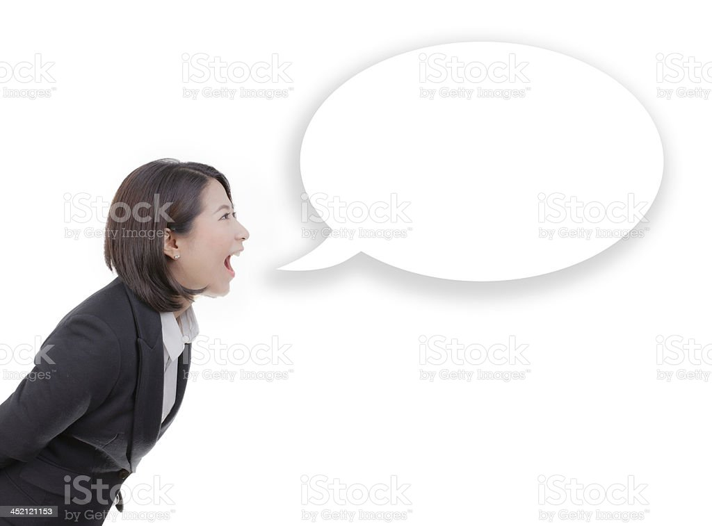 business woman screaming in blank speech bubble stock photo