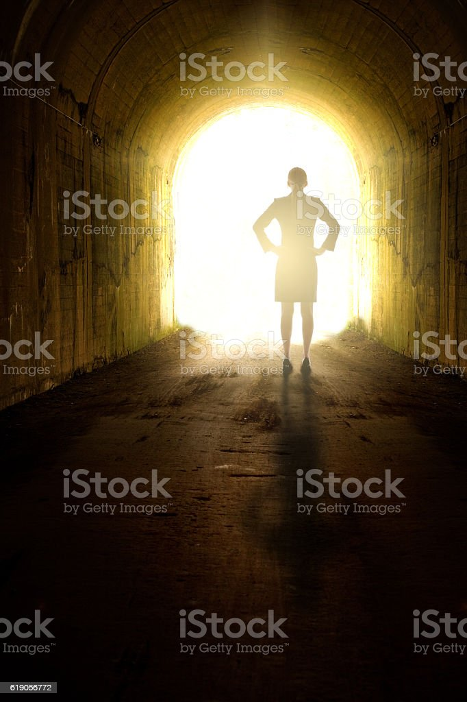 Business Woman Seeing Light At End Of Tunnel stock photo