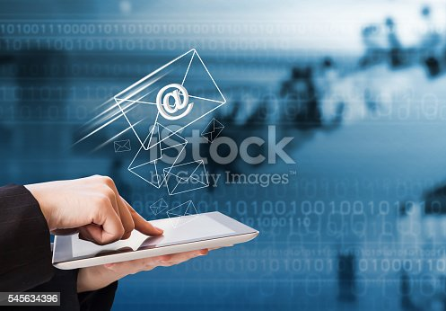 545576042 istock photo Business woman sending email by using digital tablet 545634396