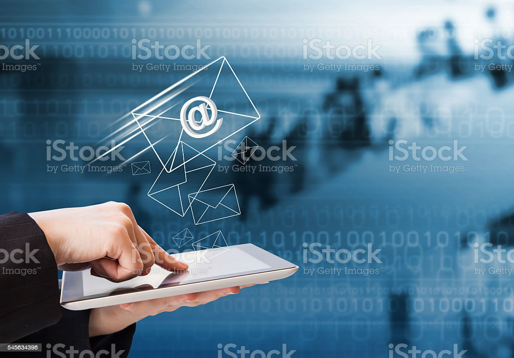 Business woman sending email by using digital tablet stock photo
