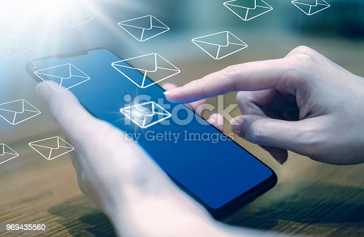 istock Business woman sending sms and email marketing by using mobile phone 969435560