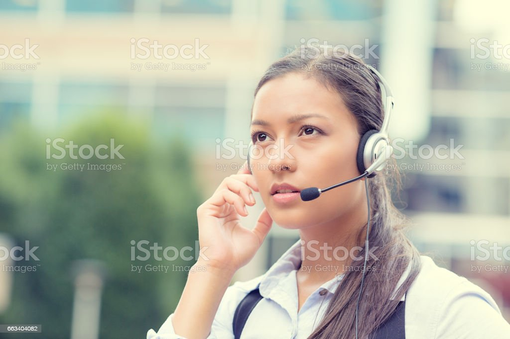 business woman, serious customer service representative call centre worker operator stock photo