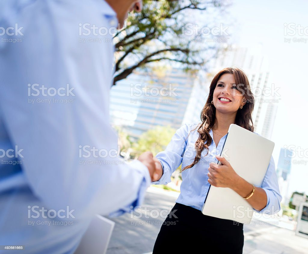 Business woman shaking hands stock photo