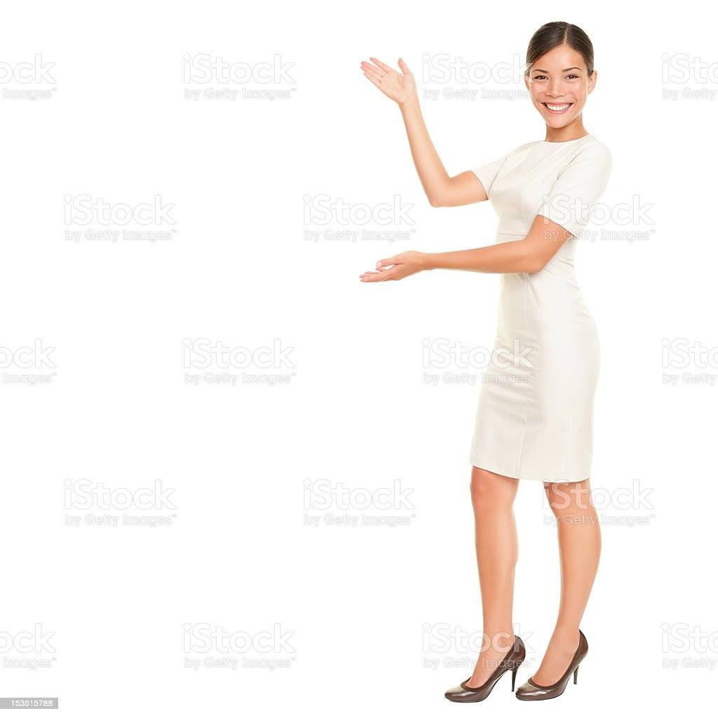 Business woman showing / presenting stock photo