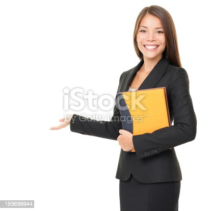 istock Business woman showing white copy space 153699944