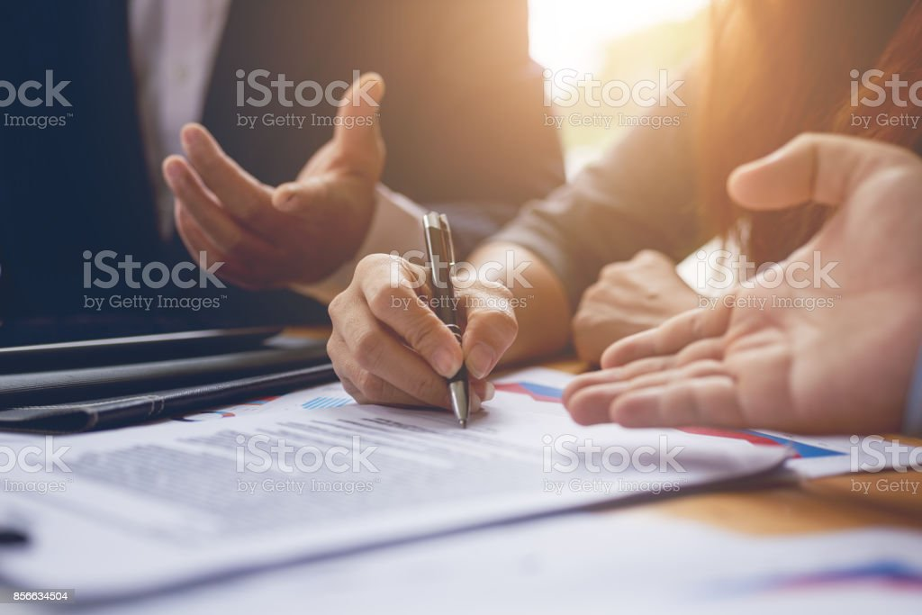 Business woman signing a contract document on office.teamwork successful Meeting Workplace strategy Concept stock photo