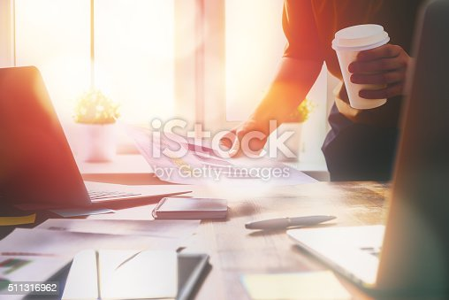 istock business woman signing documents 511316962