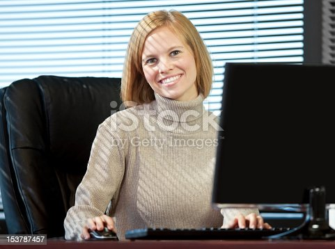 istock Business Woman Sitting At Desk In The Office 153787457