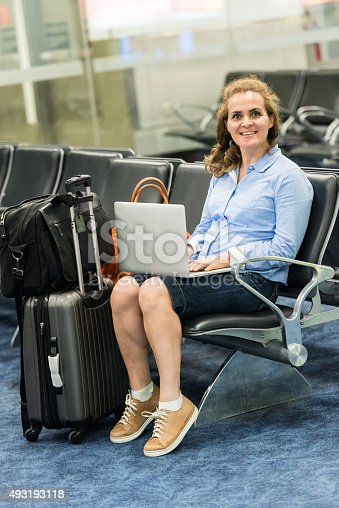 istock Business woman sitting at the airport terminal 493193118